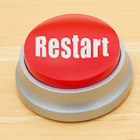 "red push button stating ""restart"""