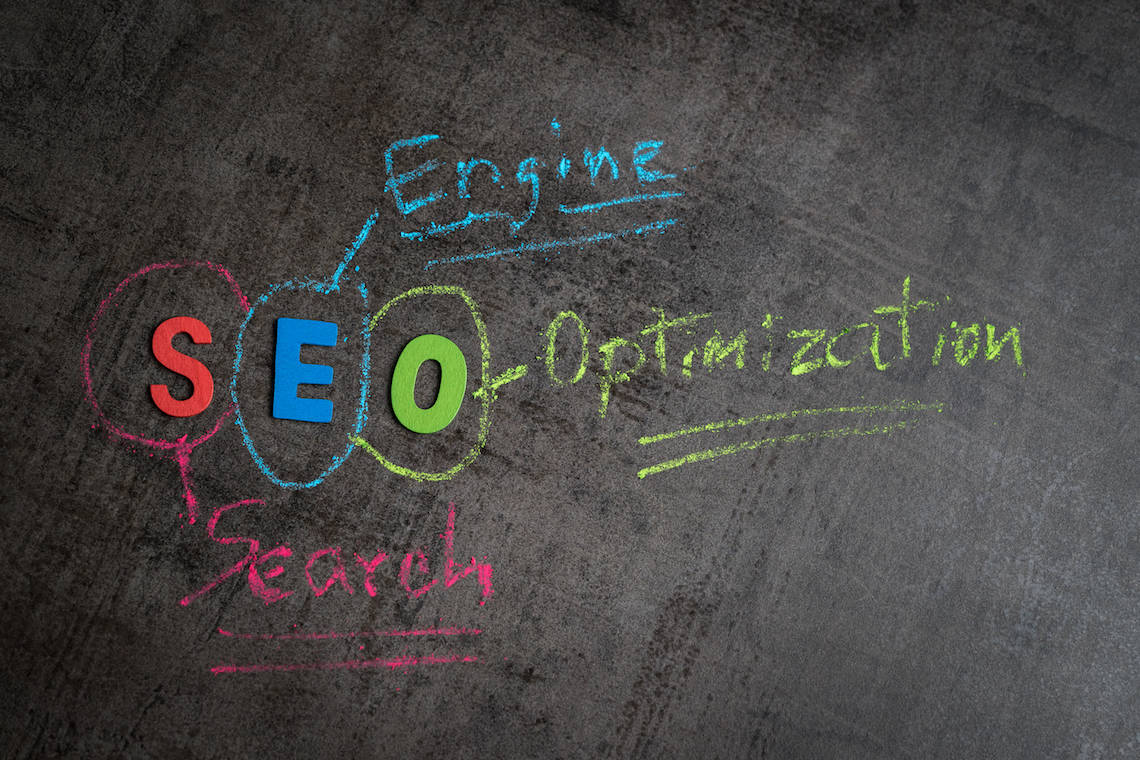 SEO written in different colors on chalkboard