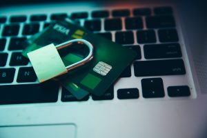 Padlock on top of credit cards and laptop