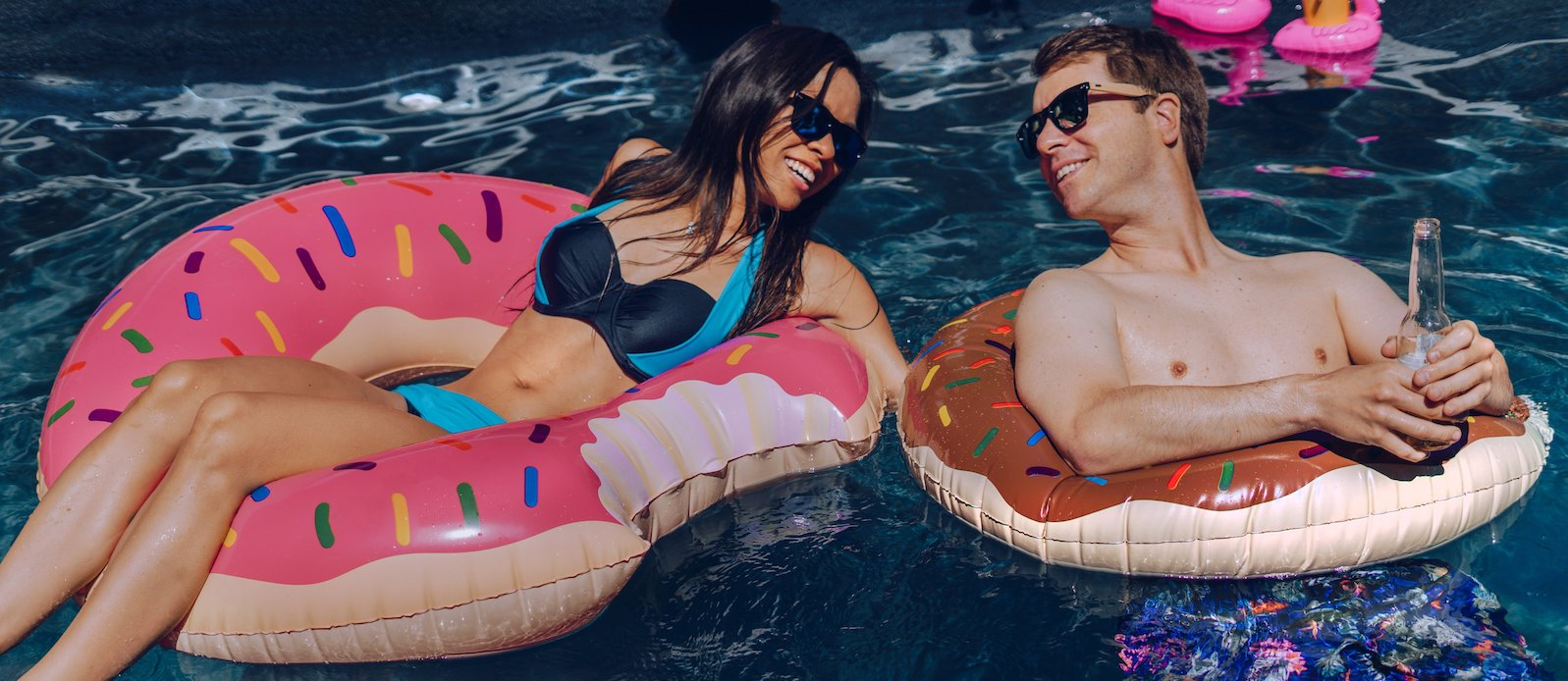 Lady and man floating in a pool